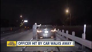 WATCH: Car plows into police officer during traffic stop