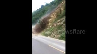 Huge landslide blocks road, trapping tourists - Video