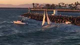 Sailboat Blown onto Rocks, Battered by Waves Before Rescue by Redondo Beach Harbor Patrol - Video