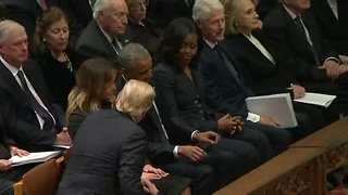 President Trump arrives to Bush funeral, greets Obamas