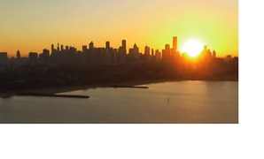 Sun Rises and Sets Over Melbourne Skyline in Timelapse - Video