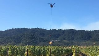 Firefighting Helicopters Pull Water from Oakville Winery - Video