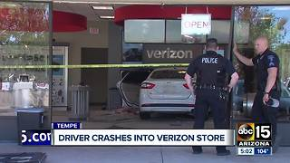 Driver crashes into Tempe Verizon store, impairment suspected - Video