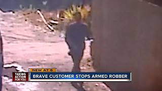 Man disarms robber, holds him until authorities arrive - Video