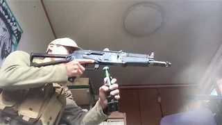 How to Open a Bottle and Reload an AKS74U - Video