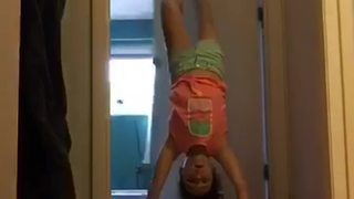 Little Girl Does a Handstand and Falls Through Open Door - Video
