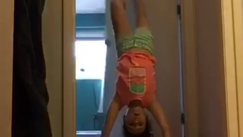 Little Girl Does a Handstand and Falls Through Open Door