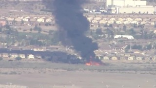 Henderson firefighters battling brush fire - Video