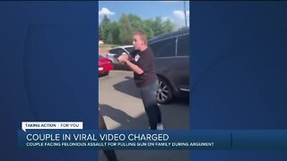 Couple in viral video charged