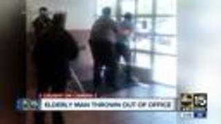 Elderly man thrown out of office by security guard - Video