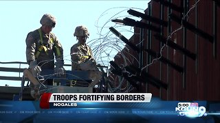 Soldiers take on fortifying border, awaiting migrant caravan