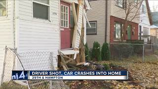 Car crashes into house after driver is shot