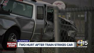 Two hurt after train strikes truck in Surprise - Video