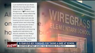 6-year-old boy told to stand after taking a knee at school - Video