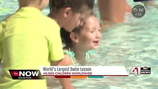 Local kids take part in World's Largest Swim Lesson - Video
