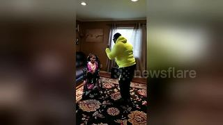Heartwarming moment dad dances to make his special needs daughter smile - Video