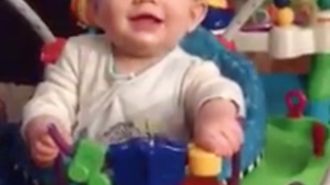 Hilarious expression of baby using Bouncy Toy