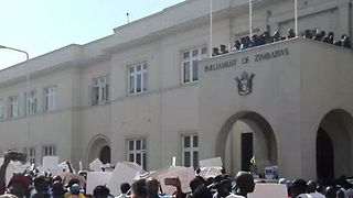 Crowds Chant Outside Parliament as Mugabe Impeachment Process Begins - Video