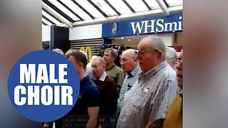 Male choir breaks into song at M5 service station - Video
