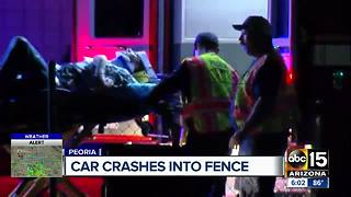 Car crashes into fence in Peoria - Video