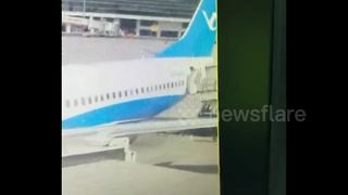 Flight attendant falls out of plane at China airport - Video
