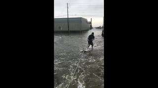 Street surfing in the Texas floods - Video