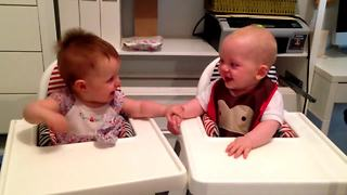 Adorable Twin Babies Engage In Hysterical Giggling Fit - Video