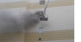 Smoke Billows From Fatal Fire at Siberian Shopping Centre - Video