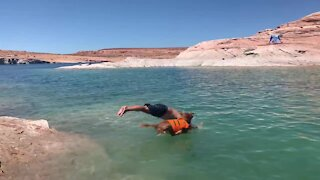 Doggy and owner go swimming in Lake Powell