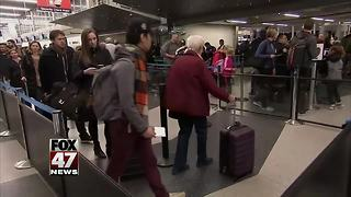 Travelers return home after holiday vacation - Video