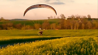 Paraglider Dangerously flies along the road  - Video