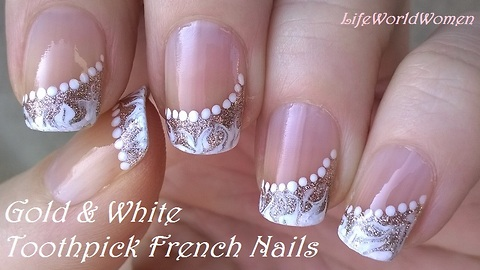 Gold & white side French manicure: Elegant drag marble nail art by toothpick