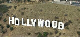 6 arrested after defacing Hollywood sign to bring awareness to breast cancer