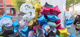Community gathers to remember 2-year-old Amari Nicholson, memorial growing
