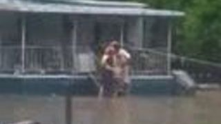 Firefighters Rescue Family From Their Flooded Home in Greenville - Video