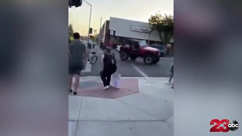 CAUGHT ON VIDEO: Jeep startles a crowd of protestors