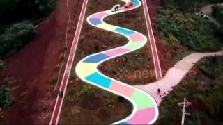 Colourful snake-shaped road in southwestern China's Chongqing City - Video
