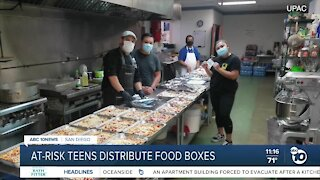 At-risk teens distribute food boxes