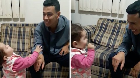 Heartwarming moment child uses sign language to communicate with deaf dad