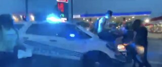 National: Video shows officer driving into protestors in Detroit