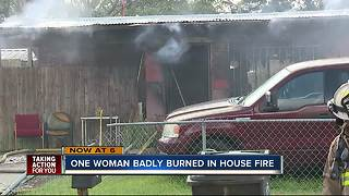 Woman burned in house fire - Video