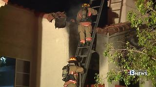 Couple throws rocks to wake up, save people from fire in burning Las Vegas apartment - Video