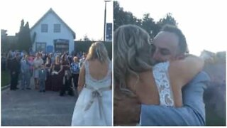 Bride and groom reveal baby's gender with baseball bat