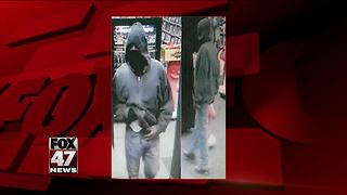 Surveillance photo released from armed robbery at video store - Video