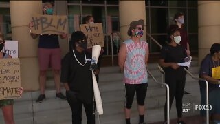 Demonstrators gather in peaceful protest outside Fort Myers Federal Court