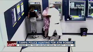 WANTED: Man who robbed woman at Amscot ATM - Video