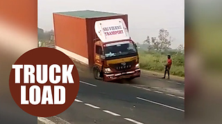 A driver was almost run over by his own truck - after it got stuck in reverse on the motorway. - Video
