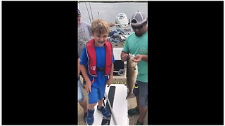Kid Is Utterly Happy To Catch His First Fish - Video