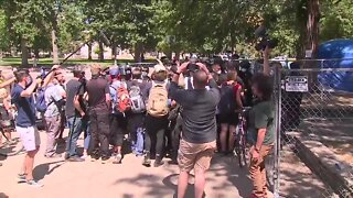 Protesters clash with Denver authorities during sweep of homeless camp in Lincoln Park