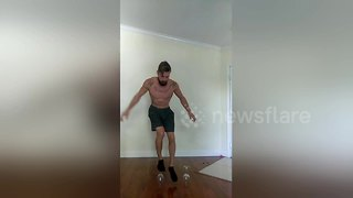 US fitness guru attempts to balance on wine glass - Video